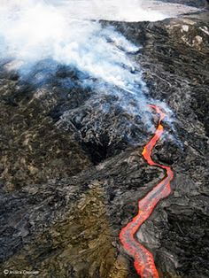 An aerial view of molten lava from a helicopter on Hawaii