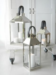 These large nickel plated stainless steel lanterns will add a contemporary touch to any setting.