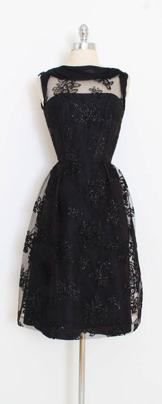 ➳ vintage 1950s dress * gorgeous glitter flocked dress! * black mesh with fuzzy flowers and sparkly glitter * acetate lined skirt * cotton bodice with stays * metal back zipper * by California condition | excellent fits like medium length 41 bodice 16 bust 37 waist 28 hips 40 ➳ shop http://www.etsy.com/shop/millstreetvintage?ref=si_shop ➳ shop policies http://www.etsy.com/shop/millstreetvintage/policy twitter | MillStVintage facebook | ...