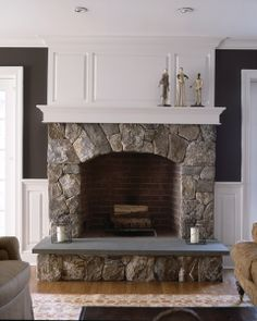 I like the combination of stone and wainscoting.