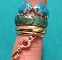 Betsey Johnson Elephant, aqua leaf, gold band, and gold band with dangling key ring set.