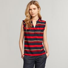 Tommy Hilfiger women's shirt. This breezy blouse is ready for work or play. Bold stripes are offset by feminine details like soft ruffles and subtle pleating, and the demure V-neck begs for a strand of pearls.• Classic fit.• 100% synthetic.• Ruffled collar and armholes, 5-button henley placket, straight hem.• Machine washable.• Imported.