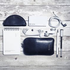 What's in my bag? #FlatLay  #WhatsInMyBag #ThisIsGround #TIGStash #CordTaco #KyokutoFOB #Notebook #Notepad #Memo #Mophie #BlackAndWhite #OlloClip #Pentel #PentelOrenz #PilotPen #PilotChoose #PowerToThePen #Apple #Minimalistic #Simple