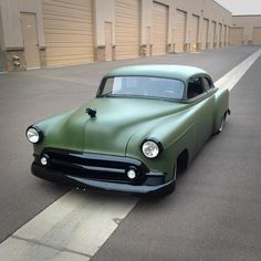 Olive drab '53 Chevy sedan with blacked out trim.Very subtle.