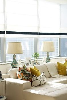 Great babyproofing decor idea... keep lamps & fragile decor on table between couch and wall, so the baby can't get to the lamps, etc. No need for end tables, either!