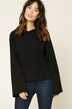Forever 21 Contemporary - A fleece knit sweater featuring a hood with drawstrings, long raglan bell-sleeves, and a boxy silhouette.