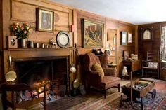 The big keeping room was added to the house in the mid-1700s. Antique furnishings include an early 19th-century tall-case clock of butternut, made in Massachusetts, and a Dan Patch wagon serving as a coffee table.