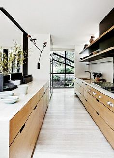 colour combination- white tops, oak or beech fronts and blackened tops, plus the black tap. lovely