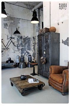 PIN 10. Found this picture through Pinterest and just love the recycling here. There are so many ways metal can be used and thought it would be a good idea to have it here. From the aluminum old lockers, and industrial ceiling lights, to the bike and then the heavy old steal wheels on the coffee table. Such a cool room. (Love the brown leather chair too to tie it all in )