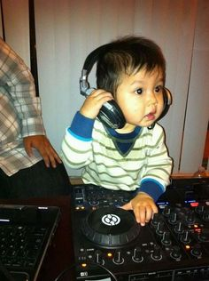 Funny kids photo...  Trying to being a DJ
