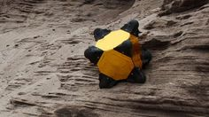 Exploring comets, asteroids, and small moons can be difficult due to their low gravity that offers practially no traction for wheeled rovers. To overcome this, a team of engineers is developing Hedgehog, a completely symmetrical robot rover for low-gravity exploration that moves by hopping.