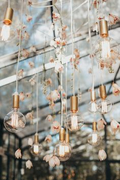 Incredible wedding event lighting: Airy, naked bulbs in rose gold metallics with blush Cymbidium orchids are suspended from the clear glass ceilings at this modern wedding reception, drifting down from the sky. See more Black, Blush and Nude Wedding Ideas Modern Wedding Reception, Wedding Reception Decorations, Wedding Themes, Wedding Centerpieces, Wedding Designs, Wedding Table, Wedding Events, Elegant Wedding, Wedding Styles