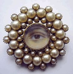Georgian eye brooch in a gold and pearl frame, circa This is an example of miniature portraits detailing an eye as a symbol of love. They took hold during the late century and continued through the early century. (From All Things Jane Austen) Victorian Jewelry, Antique Jewelry, Vintage Jewelry, Eye Jewelry, Pearl Jewelry, Jewellery, Lovers Eyes, Miniature Portraits, Mourning Jewelry