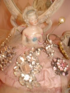Vintage German or French half dolls make great bracelet or brooch holders. Statues are perfect for hanging necklaces. My favorite find is a mini French vase shaped like a pink fish that I store my diamond hairpins in. Hope this inspires you to add a little sparkle in your life. frenchbeautymark.blogspot.com