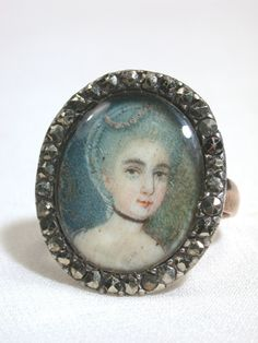 "'Bourgeoisie Extolled - Georgian Portrait Miniature Ring""... this ring combines several things that I love - marcasite (the border), cameos, and that antique look"