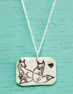 "You will receive this lovingly handmade sterling silver necklace featuring a pair of foxes enamored. Comes on an 18"" fine silver chain. Pendant measures approx 1"" wide and is made of eco-friendly recl"