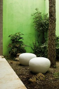 Look to lightweight fiber cement for functional outdoor furniture and accessories that are heavy on style