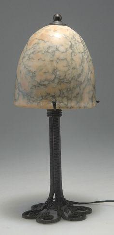 Edgar Brandt, Paris. 'Gingko' table light, 1920s. H. 40.5 cm. Blackened wrought-iron, shade of veined alabaster. Marked: E. BRANDT.  |  SOLD 1200 EUR