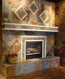 Love the slate stone for the fireplace... we gotta do this
