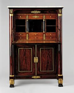 Attributed to Duncan Phyfe  Secrétaire à abattant, 1820–25  Rosewood and kingwood veneers, ebonized mahogany, gilded gesso and vert antique, gilded brass, looking-glass plate, marble; secondary woods: mahogany, white pine, yellow poplar, 60 x 40 x 19 in., Private collection Image: © The Metropolitan Museum of Art, New York
