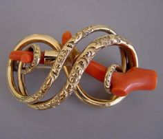 """Victorian stick coral in eternity knot brooch, extra large sized at 2-1/3"""" across - in the Victorian era, wearing coral was thought to promote good health."""
