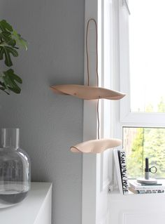 A unique and different coat stand in butter soft natural leather. This stunning coat hanger from Danish brand By Wirth is both functional and beautiful. With or without clothing, this sculptural hanger is guaranteed to dress up in any hallway or bedroom.