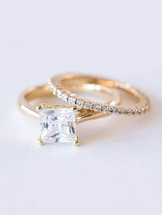 The Estée Ring A classic princess cut solitaire diamond atop a 14k gold band, this four prong engagement ring is made for the feminine, sophisticated, & classic bride. This square cut wedding ring is available in forever one moissanite or diamond. Please choose your stone type, ring