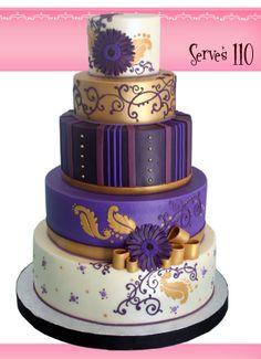 Purple and gold wedding cake http://www.thegirlwiththemostcake.com/cakes--wedding.html