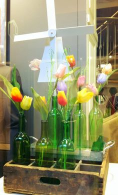 Tulips and windmill spring window display Spring Window Display, Window Display Retail, Boutique Window Displays, Store Front Windows, Retail Windows, Merchandising Displays, Store Displays, Retail Displays, Painted Branches