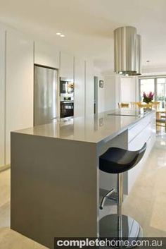 staron jayen kitchen with neutral colours and a gloss finish