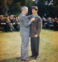 President Truman presenting the Medal of Honor to medical corpsman Desmond Doss at the White House Washington DC 12 October 1945. The medal was for his actions on Okinawa Japan. [634x678]