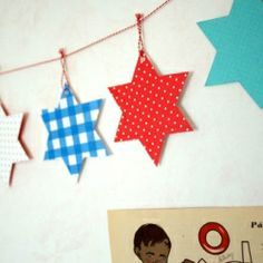 25 simple and unique Hanukkah Crafts to Make with Kids, from stained glass menorahs to star of david mobiles.