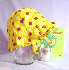 Childs summer hat beach hat sunhat red ladybugs on yellow ruffled hat. $21.50, via Etsy.