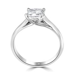 Wish features a double wishbone setting in a delicate under bezel crossover. Here featuring an Asscher cut square diamond, but also available in a round.