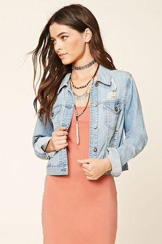 A distressed denim jacket with button-cuff long sleeves, a buttoned front, a basic collar, slanted front pockets, and buttoned chest pockets.