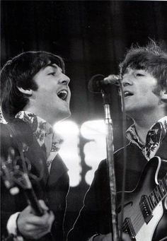 Paul McCartney and John Lennon photographed on stage in 1966