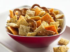 9 cups Corn Chex®, Rice Chex® or Wheat Chex® cereal (or combination) 2 cups bite-size pretzel twists 2 cups bite-size cheese crackers 3 tablespoons butter or margarine 1 package (1 oz) ranch dressing and seasoning mix 1/2 cup grated Parmesan cheese
