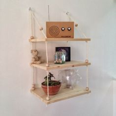 A hanging shelf tutorial - in French, but very clear, easy-to-follow pics. Love the wooden beads and unfinished wood. caractériELLE: DIY : une étagère suspendue..