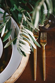 gold flatware + eucalyptus // photo by Nicole Berrett, styling by The Beauty & The Blush // http://ruffledblog.com/fuchsia-holiday-celebration