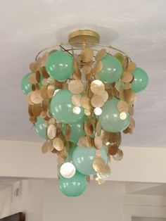 Babs.: DIY Chandelier, gold chapiz and glass balls