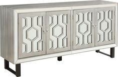 Eclectic style with a dash of charismatic glamour, the Nunley credenza takes center stage! This credenza features a grooved design and mesmerizing overlays on the mirrored door fronts. Finished in metallic pewter and faceted crystal hardware. Customer assembly is required. Customer assembly required. White Credenza, Modern Credenza, Sideboard, Wood Buffet, Buffet Cabinet, Custom Furniture, Modern Furniture, Bose, Great Rooms