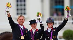 (L-R) Carl Hester, Laura Bechtolsheimer and Charlotte Dujardin of Great Britain celebrate with their gold medals during the medal cerermony for the Team Dressage on Day 11 of the London 2012 Olympic Games at Greenwich Park Team Gb 2012, Carl Hester, Charlotte Dujardin, Olympic Equestrian, Beijing Olympics, 2012 Summer Olympics, Olympic Gold Medals, Dressage Horses, Olympic Athletes