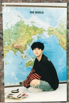 It's funny that when I read 'the world' I wasn't thinking of the map but instead of the boy in front of it