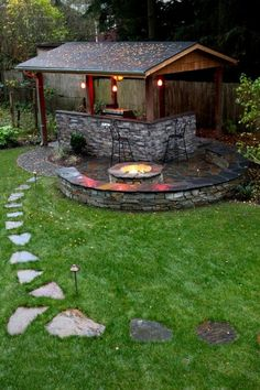 Outdoor kitchens don't have to be on the back patio! traditional patio by Father Nature Landscapes of Tacoma, Inc.