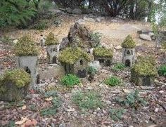 I like the look of these little houses - make in hypertufa with moss roofs? - some info on the site but not a tutorial for these houses - from Bliss's Blog