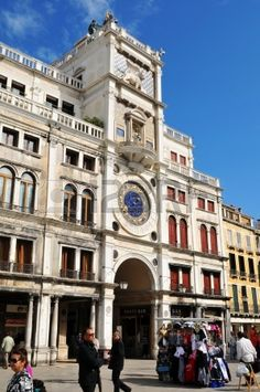 Venice, Italy - 6 May, 2012: Tourists visiting the St Mark s Clock Tower (Torre dell Orologio) in Piazza di San Marco photo