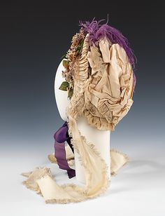 c. 1870 bonnet, British, made of silk, feathers, cotton and linen, The Metropolitan Museum of Art 2009.300.2192