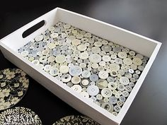 Love this idea, though I think I would do a teal, bright green and yellow color scheme with a white tray under it all.