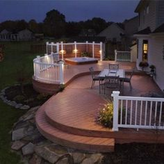 This award winning (NARI 2007 Contractor of the Year) Springboro composite deck features Timber Tech decking with a contrasting inset, multi-levels, curved edges and railing, low voltage lighting, and hot tub privacy. This project has been featured in the Dayton Daily News 2007, Cincinnati Enquirer 2009, and national in Timber Tech marketing effort.