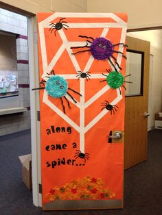 Halloween door decorating contest! Cool if our faces the spiders instead